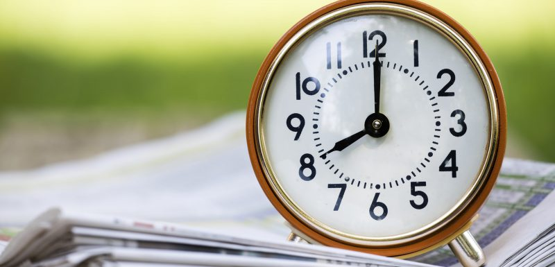 Time management - retro red alarm clock