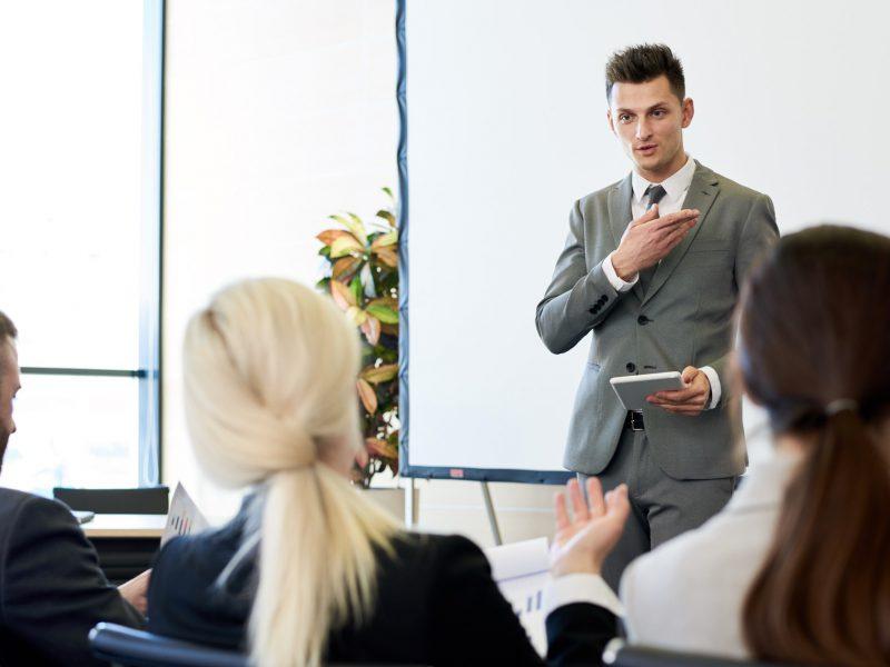 Business Coach Giving Speech in Forum