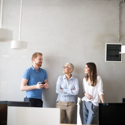 Group of business people working and communicating in office together with colleagues